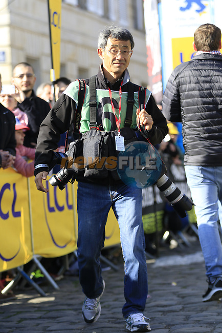 Photographer Yuzuru Sunada at sign on for the 115th edition of the Paris-Roubaix 2017 race running 257km Compiegne to Roubaix, France. 9th April 2017.<br /> Picture: Eoin Clarke | Cyclefile<br /> <br /> <br /> All photos usage must carry mandatory copyright credit (&copy; Cyclefile | Eoin Clarke)