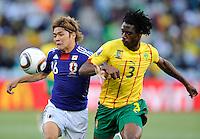 Yoshito Okubo of Japan and Nicolas Nkoulou of Cameroon