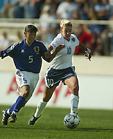 Aly Wagner, left, battles for the ball with Japan's Tomoe Sakai, during a 0-0 tie in San Diego, Calif., January 12, 2003.