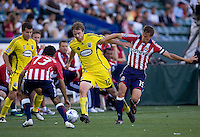 Columbus Crew's Eddie Gaven (12) is marked by Chivas USA's Jonathon Bornstein (l) and Jesse Marsch (13). Chivas USA defeated the Columbus Crew 2-1at Home Depot Center stadium in Carson, California on Sunday April 5, 2009.  .Photo by Michael Janosz/ isiphotos.com