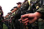 A young FARC girl holds her gun in formation just outside of San Vicente del Caguan in the former FARC controlled zone of Colombia. The FARC are Colombia's oldest and largest rebel group numbering over 18,000 rebels. Many of the rebels are young teenagers. (Photo/Scott Dalton)