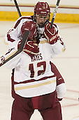 Johnny Gaudreau (BC - 13) celebrates his goal with Kevin Hayes (BC - 12). - The Boston College Eagles defeated the visiting Rensselaer Polytechnic Institute Engineers 7-2 on Sunday, October 13, 2013, at Kelley Rink in Conte Forum in Chestnut Hill, Massachusetts.