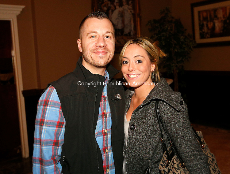 """Waterbury, CT- 09 April 2015-040915CM11-  Social moments--- From left, Jonathan Chabre of Terryville and Sabrina Grasso of Waterbury are photographed during The Eighth  Annual """"Wishes From Waterbury""""  wine and beer tasting to benefit Make-A-Wish Foundation of Connecticut, at La Bella Vista, Ponte Club, in Waterbury on April 9th, 2015.  Christopher Massa Republican-American"""