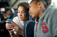 STANFORD, CA--Freshmen Erica Payne and Jasmine Camp share a moment on their mobile device as they make their way to the airport en route to Norfolk, VA for the first and second rounds of the 2012 NCAA tournament.