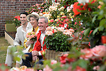"Michael Peluso, Maureen Lipman and Michael Pattemore pose with the new roses named the ""Lynda Bellingham Rose"" At the RHS Hampton Court Flower show, London 29.6.15"