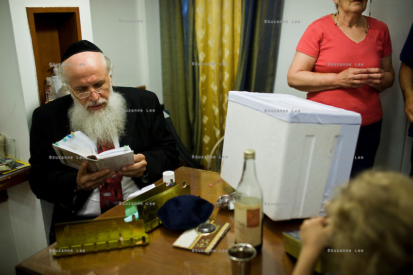 Jonathan Isaac Newman (ref: portraits for more details on Jonathan) reads his prayer book during the celebrations and singing at Chabad Bangkok (Khao San road), Thailand for Chanuka celebrations on 12th December 2009..Photo by Suzanne Lee / For Chabad Lubavitch