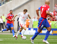 Miroslav Szymkowiak (10) of Poland motors between Ronald Gomez (11) and Luis Marin (3) of Costa Rica. Poland defeated Costa Rica 2-1 in their FIFA World Cup Group A match at FIFA World Cup Stadium, Hanover, Germany, June 20, 2006.