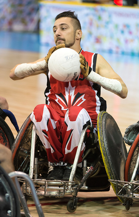 MISSISSAUGA, ON, AUGUST 12, 2015. Wheelchair Rugby - Canada vs USA in preliminary action. USA won the game 60-59 in double overtime - Patrice Simard<br /> Photo: Dan Galbraith/Canadian Paralympic Committee