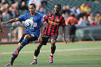 Edgar Castillo (left) heads the controls the ball ahead of Shaun Wright-Phillips (right) Manchester City defeated Club America 2-0 in the Herbalife World Football Challenge 2011 at AT&T Park in San Francisco, California on July 16th, 2011.
