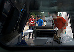 "During the 2006 Mid America Print Council conference ""Forging Connections"" at Ohio University on Friday, 9/22/06, artist Greg Nanney prints with the drive-by press he and Joseph Velasquez are taking around the U.S. in the back of a pick-up truck. The conference runs from September 20-23. Around 700 printmakers, students, curators and other art professionals are expected to attend the biennial event."