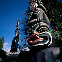 Close Up Detail of Kwakwaka'wakw (Kwakiutl) Totem Pole, called Ga'akstalas, at Brockton Point in Stanley Park, Vancouver, British Columbia, Canada, in Spring.  Grizzly Bear sits above Dzoonokwa (Wild Woman of the Woods).