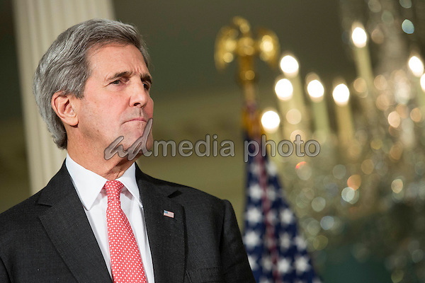 United States Secretary of State John Kerry looks on as U.S. President Barack Obama makes a statement after meeting with his National Security Council at the State Department, February 25, 2016 in Washington, DC. The meeting focused on the situation with ISIS and Syria, along with other regional issues. Photo Credit: Drew Angerer/CNP/AdMedia
