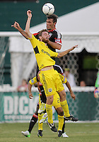 WASHINGTON, DC - AUGUST 4, 2012:  Emilliano Dudar (19) of DC United heads over Eddie Gaven (12) of the Columbus Crew during an MLS match at RFK Stadium in Washington DC on August 4. United won 1-0.