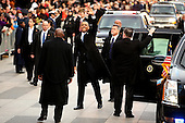 United States President Barack Obama waves as he exits the presidential limo as the inaugural parade winds through the nation's capital January 21, 2013 in Washington, DC. Barack Obama was re-elected for a second term as President of the United States. .Credit: Chip Somodevilla / Pool via CNP