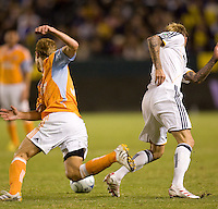 Houston Dynamo defender Andrew Hainault and LA Galaxy midfielder David Beckham turn back to the ball during the Western Conference Final. The LA Galaxy defeated the Houston Dynamo 2-1 to win the MLS Western Conference Final at Home Depot Center stadium in Carson, California on Friday November 13, 2009.....
