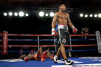 Kendall Holt  (r) celebrate after knocking  Isaac Hlatswayo down for the third  time during their Vacant NABO Junior Welterweight 12 rounds title fight at the Bally's hotel casino in Atlantic City, N.J. on 11.03.2006.&amp;#xD;Holt won by unanimous decision and moved to 21 - 1.<br />