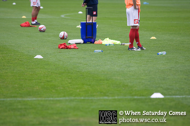 Crewe Alexandra players cones and bibs strewn across the pitch as they warm up prior to their League 2 fixture against Aldershot Town at the Alexandra Stadium. The visitors won by 2 goals to 1.