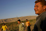 Kurdish men play volleyball outside a small village in Central Kurdistan...Stability and security prevail in postwar Iraqi Kurdistan as Iraqi tourists, many of them from Baghdad, flock to the northern cities and their amusement parks and national parks to escape violence and sectarian strife in the central and southern regions of the country.