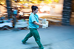 Project HOPE volunteer nurse Alysia Monaco carries supplies to a patient at the Hospital Albert Schweitzer on Friday, October 29, 2010 in Deschapelles, Haiti.