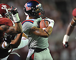 Ole Miss' Randall Mackey (1) scores vs. Alabama linebacker Trey Depriest (33) at Bryant-Denny Stadium in Tuscaloosa, Ala. on Saturday, September 29, 2012. Alabama won 33-14. Ole Miss falls to 3-2.