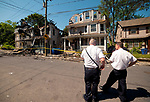 WATERBURY,  CT-051817JS08- Investigators were on the scene early Thursday to assess the damage the day after a fire destroyed four homes on Lounsbury Street  in Waterbury.  <br /> Jim Shannon Republican-American