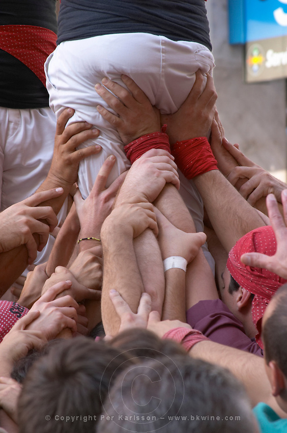 Human tower competition, castellers,  Hands grabbing. Sitges, Catalonia, Spain
