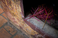 The remains of incense outside of a prayer area at the Giac Vien Pagoda in District 11 in Ho Chi Minh City, Vietnam. Photo taken Monday, May 3, 2010..Kevin German / LUCEO