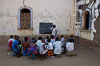 27 September 2011, Quipungo, Huila, Angola. A common sight in Angola, teaching takes place in any available space, often outside under a Jacaranda tree. This school : Padre Leonardo Sikufunde School is located inside the church, Nossa Senhora Fatima.