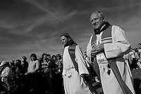 Czech catholic priests walk among believers at the end of the open-air mass served by the Pope Benedict XVI in Stara Boleslav, one of the main pilgrimage site of the Czech Republic, September 28, 2009.