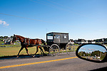 Old Order Mennonites travel by horse and buggy because they believe that the more conveniences one has, the faster-paced their life becomes. By eliminating modern conveniences and worldly distractions they are able to focus more on family and service to God.