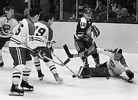 Seals vs Los Angeles Kings: King goalie Gerry Desjardins, #19 Butch Goring, and #15 Ted Irving. Seals #18Joe Szura ..(1969 photo/Ron Riesterer)