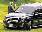An unidentified security person holds the door of an SUV for Donald Trump (visible through the windshield), a candidate for the 2016 Republican nomination for President of the United States, as he arrives to appear at the ribbon cutting for the Albemarle Estate at the Trump Winery in Charlottesville, Virginia on Tuesday, July 14, 2015. <br /> Credit: Ron Sachs / CNP<br /> <br /> (RESTRICTION: NO New York or New Jersey Newspapers or newspapers within a 75 mile radius of New York City)
