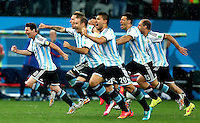 Lionel Messi of Argentina leads his side as they celebrate their penalty shoot out win over the Netherlands to qualify for the World Cup final vs Germany