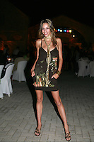 September 23, 2007; Patras, Greece;   Almudena Cid of Spain posing for fashion type photo at banquet after 2007 World Championships Patras.  Almudena's 11th place finish at Patras won for Spain a place in the individual competition at 2008 Beijing Olympic Games and the possibility of Almu's 4th Olympics. Photo by Tom Theobald. <br /> <br /> Photo note: Was so big surprise to me, when Almudena requested fashion photo. Had little time to think up something quick in the moment. I know she is very familiar with this kind of photo work.  (Really for me, I have done only a little fashion photograhy. Ok, I try think ahead and be ready next time...ie. setup long pc cord for flash and handhold off-camera, move in closer:)
