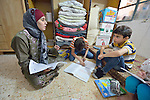 Ahlam Mazatha supervises the homework of her sons Mohammed, 13, and Abed Rahaman, 10, and her daughter Sarah, 5, in their small apartment in Madaba, a sprawling Palestinian refugee camp in Jordan that has grown in recent years with the arrival of refugees--like this family--from war-torn Syria. She and her husband and three children fled Daraa in 2013 when bombing destroyed their home. Mazatha was a teacher in Syria, and her husband owned a taxi, but in Jordan they are not allowed to work by the government. The  Department of Service for Palestinian Refugees of the Middle East Council of Churches, a member of the ACT Alliance, provides a variety of services here, including medical care.