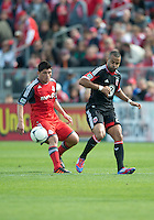 05 May 2012: D.C. United forward Maicon Santos #29 and Toronto FC defender Miguel Aceval #3 in action during an MLS game between DC United and Toronto FC at BMO Field in Toronto.