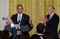 United States President Barack Obama (L) and Vice President Joe Biden attend a reception for Hispanic Heritage Month in the East Room of the White House on October 12, 2016 in Washington, DC. <br /> Credit: Olivier Douliery / Pool via CNP /MediaPunch