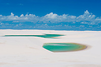 Green rainwater  ponds trapped in white dunes, Lencois Maranhenses National Park, Brazil, Atlantic Ocean