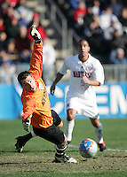 New Mexico goalkeeper Mike Graczyk (l) and Maryland's A.J. Godbolt (5) watch a Maryland shot go just wide of the net. The University of Maryland Terrapins defeated the University of New Mexico Lobos 1-0 in the Men's College Cup Championship game at SAS Stadium in Cary, NC, Friday, December 11, 2005.