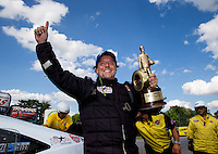 Sept. 2, 2013; Clermont, IN, USA: NHRA pro mod driver Mike Janis celebrates after winning the US Nationals at Lucas Oil Raceway. Mandatory Credit: Mark J. Rebilas-