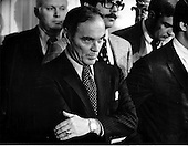 "General Alexander Haig (United States Army, ret.), White House Chief of Staff, listens to United States President Richard M. Nixon as he holds his second press conference in 2 weeks in the East Room of the White House in Washington, D.C. on March 6, 1974.  In his remarks, the President promised to submit to all questions of the U.S. House Judiciary Committee looking into the Watergate matter and would give a sworn reply to all of the Committee's questions.  The President went on to say he rejected the hush-money plan to the Watergate defendants and never promised them clemency..Credit: Benjamin E. ""Gene"" Forte / CNP"