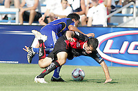Roger Espinoza (blue) and Darlo Bottinelli.tassle for the ball..Kansas City Wizards and Atlas (Mexico) played to a 0-0 tie at Robert R Hermann Stadium, on the campus of Saint Louis University, St Louis , Missouri.