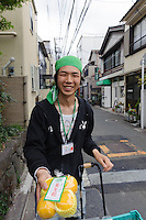 """A man sells citrus fruit on the street, Yanaka, Tokyo, Japan, April 19, 2012. Yanaka is part of Tokyo's """"shitamachi"""" historic working class wards. Recently it has become popular with Japanese and foreign tourists for its many temples, shops, restaurants and relaxed atmosphere."""