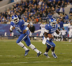 Kentucky Wildcats running back Raymond Sanders (4) and Kentucky Wildcats quarterback Jalen Whitlow (13) run the ball during the first half of the UK Football game v. Samford at Commonwealth Stadium in Lexington, Ky., on Saturday, November 17, 2012. Photo by Genevieve Adams | Staff
