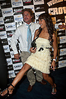 """MARK OCCHILUPO (AUS) and  wife MAE.COOLANGATTA, Australia (Thursday, February 26, 2009) - The ASP World Champions' Crowning took place tonight at the Gold Coast Convention and Exhibition Centre beginning at 6:30pm.. .Surfing's """"night of nights"""", the ASP World Champions' Crowning, was a gala event, hosting the world's best surfers as well as distinguished figures from the surfing industry in honor of the 2008 ASP World Champions.. .Kelly Slater (USA), 36, reigning and nine-time ASP World Champion, accepted his unprecedented ninth ASP World Title award just days before beginning his hunt for an incredible 10th Crown at the upcoming Quiksilver Pro Gold Coast presented by LG Mobile.. .Stephanie Gilmore (AUS), 21, reigning two-time ASP Women's World Champion, received her second consecutive ASP Women's World Title cup, and the young natural-footer will soon embark on a campaign to make it a three-peat in 2009. Gilmore will begin this weekend at the opening event of the 2009 ASP Women's World Tour season, the Roxy Pro Gold Coast presented by LG Mobile.. .Other ASP Dream Tour athletes  recognized were respective Runner-Ups Bede Durbidge (AUS), 25, and Silvana Lima (BRA), 24, as well as Rookies of the Year Dane Reynolds (USA), 23, and Nicola Atherton (AUS), 22.. .Bonga Perkins (HAW), 36, and Joy Monahan (HAW), 22, took out the ASP World Longboarding and ASP Women's World Longboarding Titles respectively, while Nathaniel Curran (USA), 24, and Sally Fitzgibbons (AUS), 18, took home hardware for their respective No. 1 finishes on the ASP World Qualifying Series last season.. .In addition to honoring the champions from 2008, the ASP World Champions' Crowning also recognized athletes who  earnt the 2008 ASP World Tour 'Most Improved',  a tie between Adrian Buchan (AUS) and Adrian de Souz (BRA) the 2008 ASP Women's World Tour 'Most Improved',Melanie Bartels (Haw) the ASP Service to the Sport Award Alexandre Fontes (BRA) and the prestigious Peter Whittaker Award take out by Taylor"""