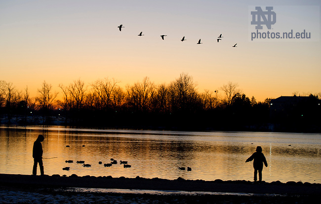 December 11, 2011; Children play along the shore of St. Mary's Lake. Photo by Barbara Johnston/University of Notre Dame