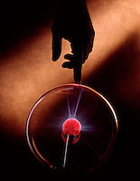hand finger glass globe generate static electricity copy space