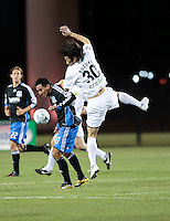 Arturo Alvarez (10) and Takayuki Suzuki (30) go up for the ball. San Jose Earthquakes defeated Portland Timbers 1-0 at Buck Shaw Stadium in Santa Clara, California on March 14th, 2009.