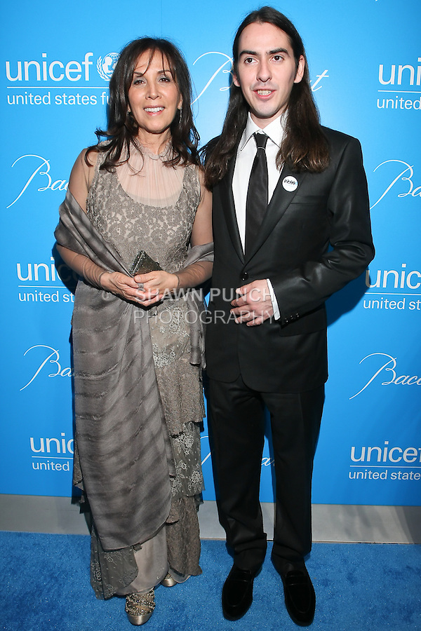 Olivia Harrison, and her son musician Dhani Harrison, arrive at the UNICEF Snowflake Ball, Presented by Baccarat, at Cipriani 42nd Street, November 30, 2010.