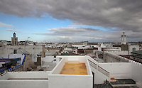 Rooftops of the medina or old town of Tetouan with the minarets of the 18th century Zaouiat Sidi ali Benraisoun or Octagonal Mosque on the left and the 19th century Jamaa el Kebir or Great Mosque on the right, on the slopes of Jbel Dersa in the Rif Mountains of Northern Morocco. Tetouan was of particular importance in the Islamic period from the 8th century, when it served as the main point of contact between Morocco and Andalusia. After the Reconquest, the town was rebuilt by Andalusian refugees who had been expelled by the Spanish. The medina of Tetouan dates to the 16th century and was declared a UNESCO World Heritage Site in 1997. Picture by Manuel Cohen